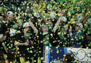 Oregon celebrates after defeating Washington 68-48 in an NCAA college basketball game in the final o