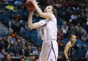 Stanford's Alanna Smith drives into Washington's Amber Melgoza during the second half of an NCAA col
