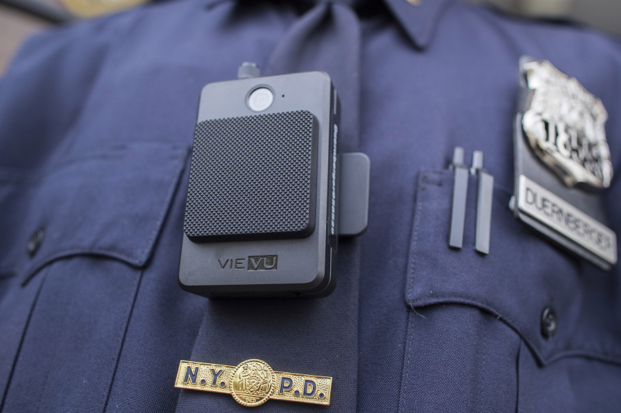 A police officer wears a newly-issued body camera outside in New York in 2017. Law enforcement and justice officials met last week to discuss the implementation of body-worn cameras in Clark County, and all agreed that now is the time to act.