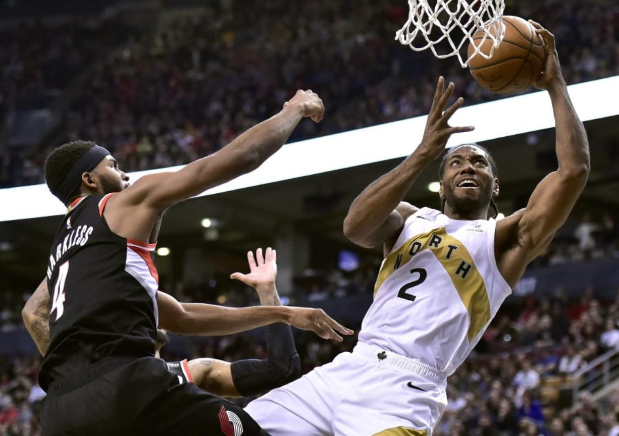 Toronto Raptors forward Kawhi Leonard (2) shoots as Portland Trail Blazers forward Maurice Harkless (4) defends during the second half of an NBA basketball game Friday, March 1, 2019, in Toronto.