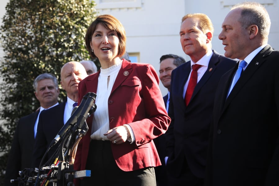 Rep. Cathy McMorris Rodgers, R-Wa., together with Rep. Kevin Brady, R-Texas, left, Rep. Rep. Steve Scalise, R-La., right, Rep. Vern Buchanan, R-Fla., second from right, and other Republican members of Congress speaks to reporters outside the West Wing of the White House following a meeting with President Donald Trump at the White House in Washington, Tuesday, March 26, 2019. (AP Photo/Manuel Balce Ceneta)