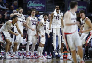 Gonzaga players celebrate as they lead Pepperdine with seconds left in the second half of an NCAA se