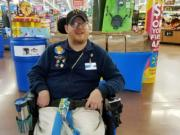 Walmart greeter John Combs works at a Walmart store in Vancouver.