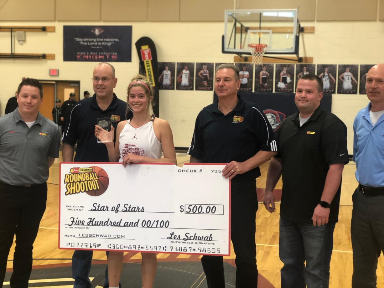 Prairie senior and Portland State commit Cassidy Gardner accepts the MVP award at the 24th annual Les Schwab Roundball Shootout at King's Way Christian. (Andy Buhler/ The Columbian)