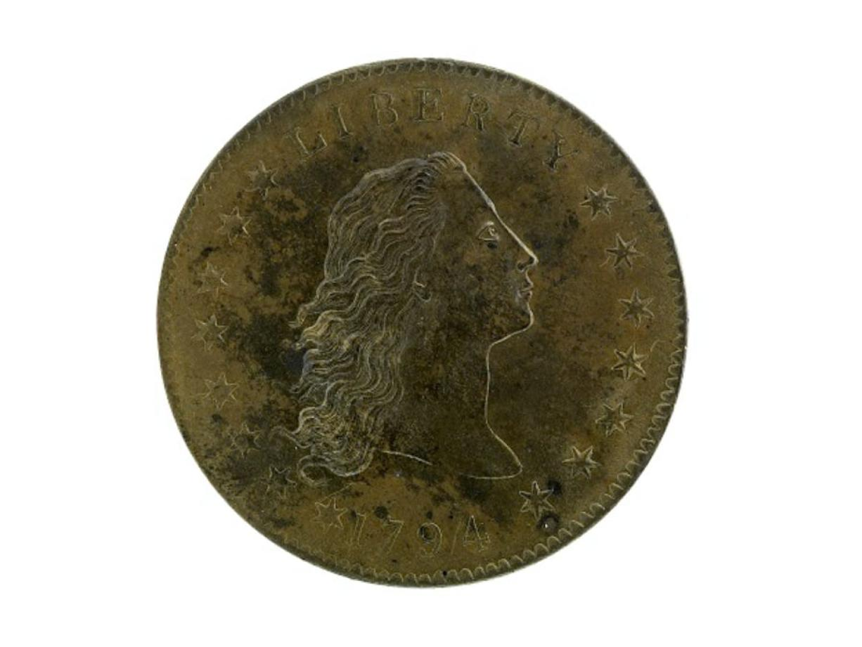 A copper $1 coin minted two years after the dollar was established. Jaclyn Nash/National Museum of American History