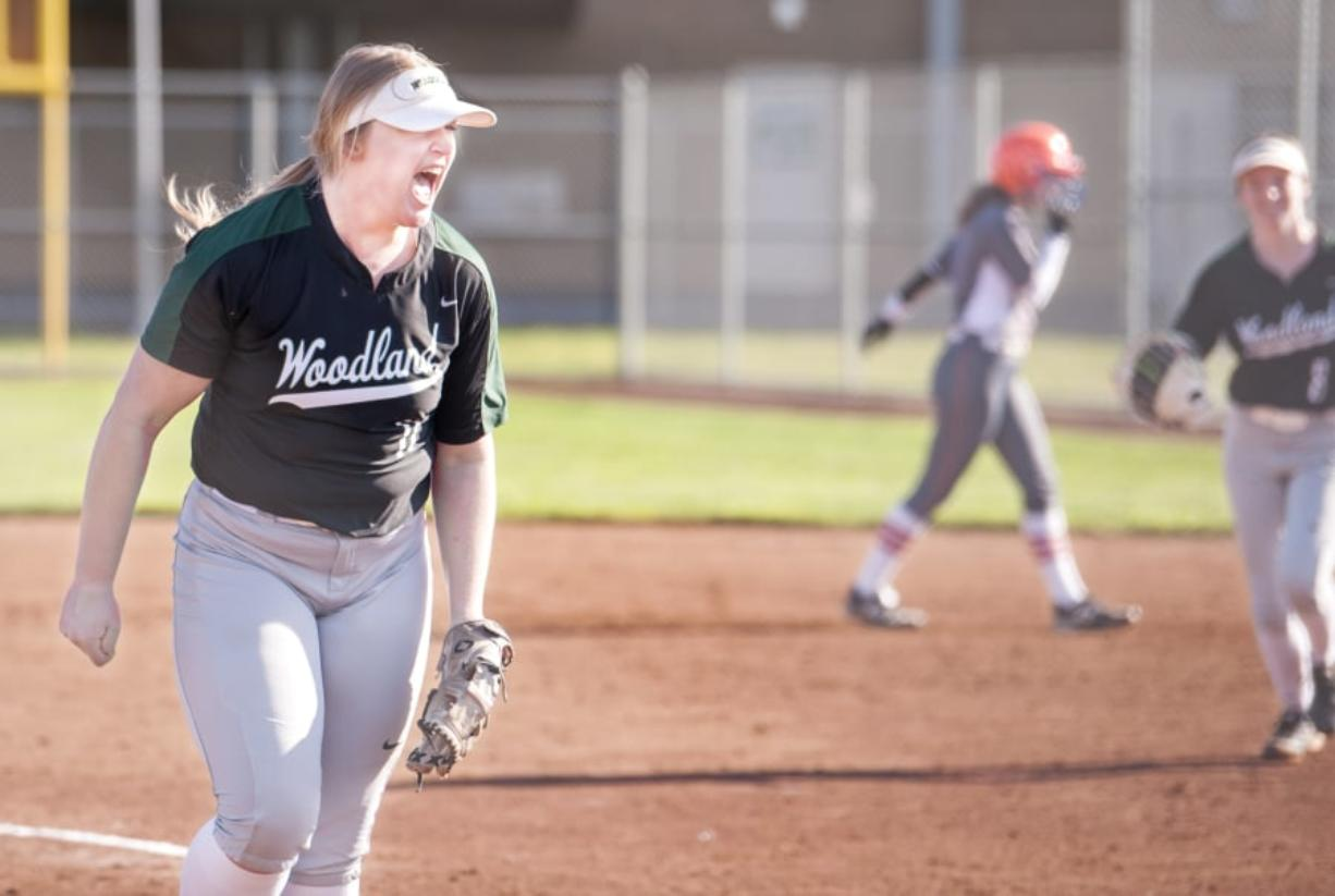 Woodland pitcher Olivia Grey lets out a roar after striking out her 16th batter to end a 2A Greater St. Helens League softball game on Wednesday in Woodland. The Beavers won 4-0 over Ridgefield.