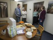The accounting team greets members of the newsroom during an open house at The Columbian in Vancouver on Tuesday.