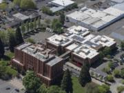 An aerial view of the Clark County Courthouse, front, and Clark County Jail behind it in downtown Vancouver.
