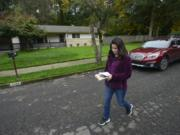 Candidate Monica Stonier walks a Vancouver neighborhood in October 2016, talking to residents about the upcoming election.