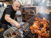Juan Olguin Sr. grills chicken at Don Juan Corner Cafe, the restaurant he and his son Juan Olguin Jr. own and operate together in Vancouver. The elder Olguin starts preparing the weekend specials like pollo asado al carbon at 1 a.m.