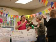 Orchards: Orchards KinderCare Learning Center prekindergarten teacher Kimberly Green was surprised with KinderCare Education's Legacy Award and a $5,000 check during a Dr. Seuss party in her class.