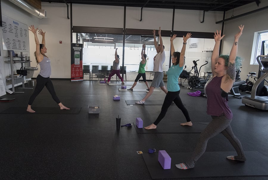81ad8e9fb0 Yoga instructor Mandy DeBord leads the class during lunchtime yoga at  Bridge Chiropractic in Salmon