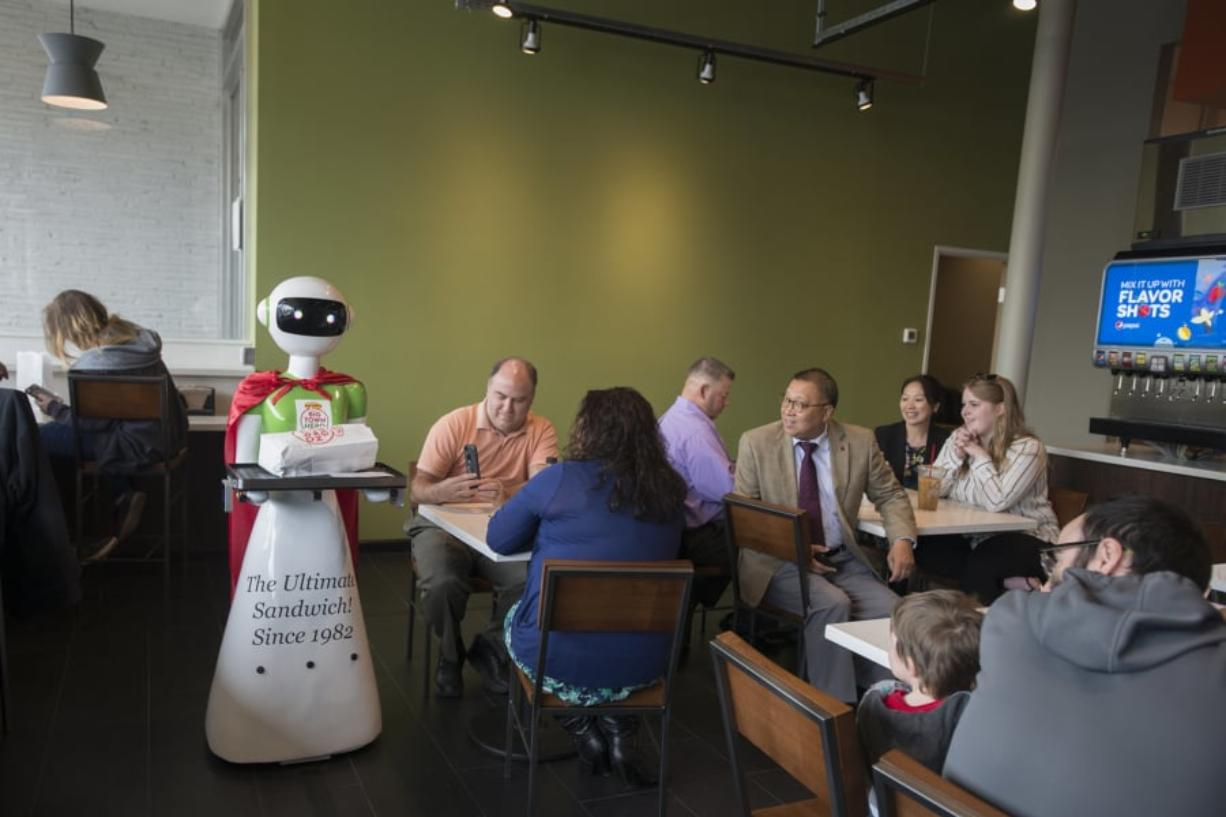 A robot delivers the lunch order for a customer at the new Big Town Hero in downtown Vancouver. The sandwich shop, which opened Thursday, is one of 14 locations in Oregon and Washington.