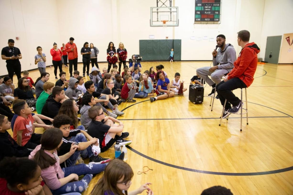 Bagley Downs: Portland Trail Blazer Moe Harkless surprised more than 70 kids at a youth basketball clinic in Vancouver on March 22. He led their clinic, answered questions, signed autographs and posed for pictures. Randy L.