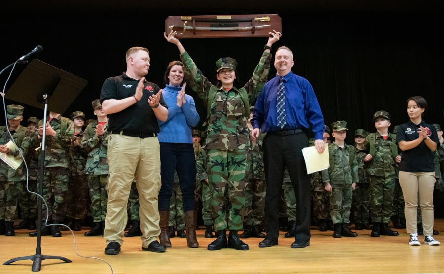 Youth member of the Young Marines graduates recruit training