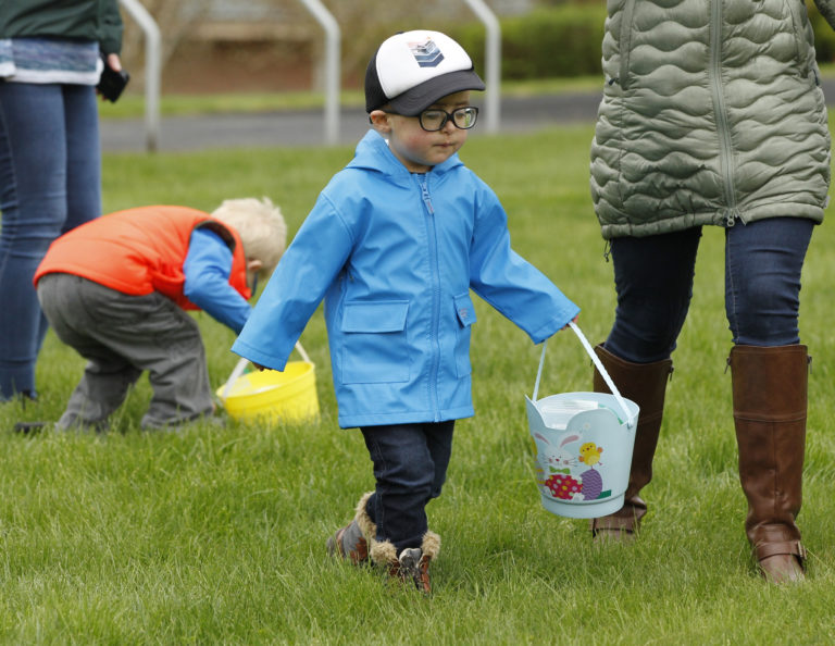 Carson Monteleone, 3, of Portland, enjoys the Washington School for the Blind Easter egg hunt for visually-impaired kids.(Steve Dipaola for the Columbian)