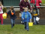 Children hunt for beeping Easter eggs at the Washington State School for the Blind on Saturday morning. The Easter egg hunt used beeping eggs, for visually impaired kids, but their sighted siblings could join in.