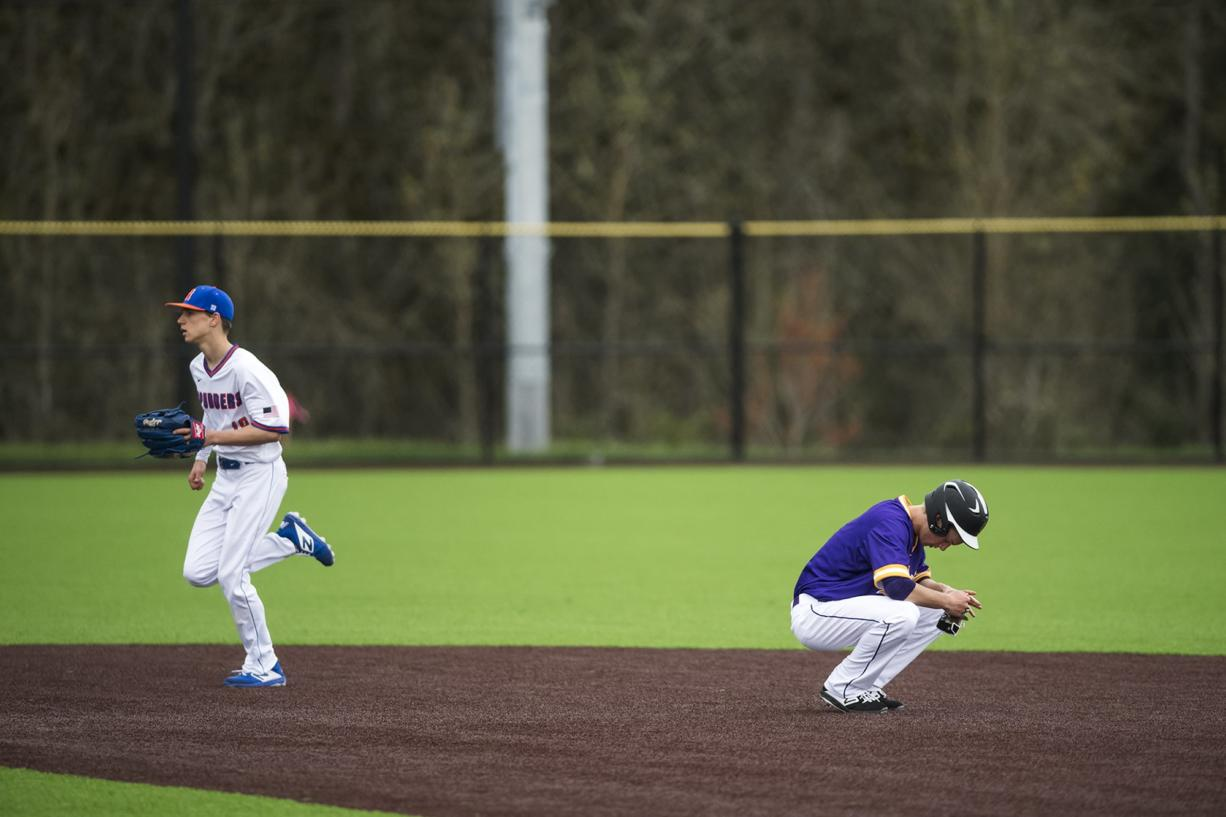 Columbia River's Cole Delich reacts to being called out at Second Base during a game against Ridgefield at the Ridgefield Outdoor Recreation Center on Tuesday night, April 16, 2019.