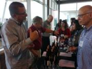 Members of the Southwest Washington Winery Association address attendees at the recent Travel & Words Conference, held at a space under construction at The Waterfront Vancouver. Pictured are Dave Kelly, from left, Richard Meyerhoefer and Joe Leadingham.