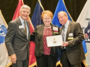 Northeast Hazel Dell: Columbia River chapter of the Military Officers Association of America President Evelyn Brady accepts the chapter's 12th consecutive 5-Star Level of Excellence Award from the national organization.
