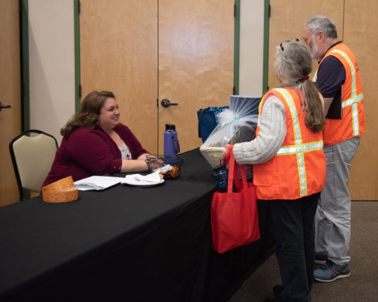 Lianne Martinez, emergency preparedness coordinator at Clark County Public Health, speaks with volunteers at a ceremony Thursday night at St. Joseph Catholic Church's parish hall.