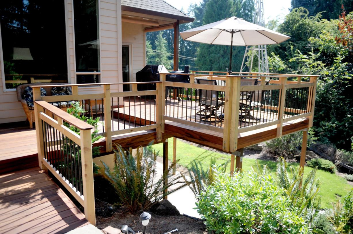 A deck doesn't have to be large to make an impression. A well-designed deck will enhance the backyard while still leaving room for landscaping.