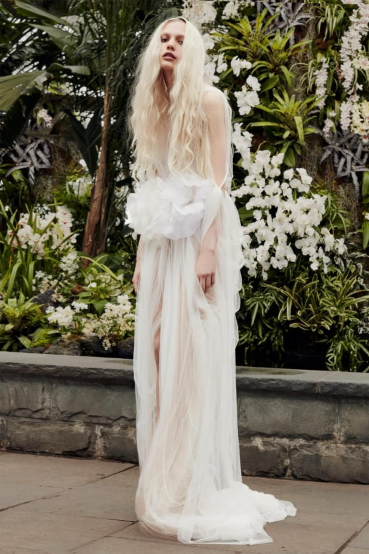 This image released by Vera Wang shows a gown from her bridal collection being modeled in New York.