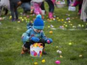 Jasper Poulton collects Easter eggs in Ridgefield during a 2018 egg hunt.