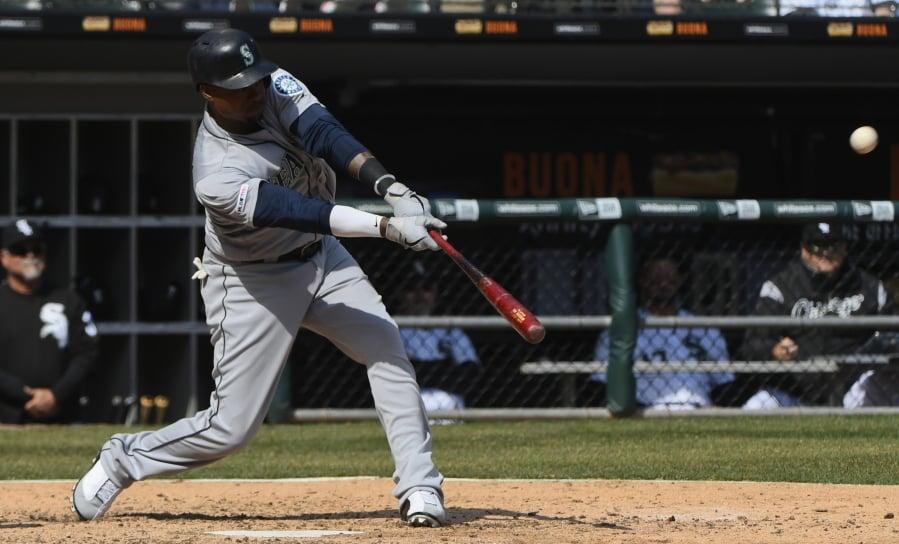 881c874f7fa Seattle Mariners' Tim Beckham (1) hits a three-run home run against