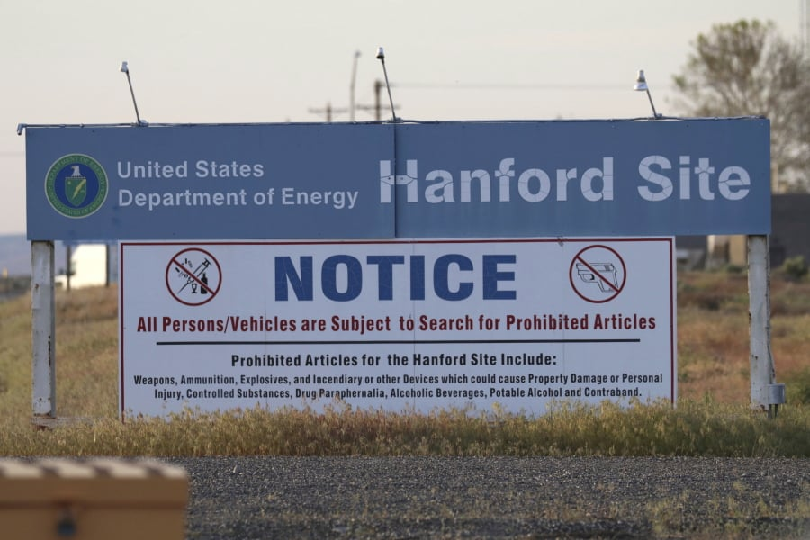 FILE - In this May 9, 2017, file photo, signs are posted at a entrance to the Hanford Nuclear Reservation in Richland, Wash.