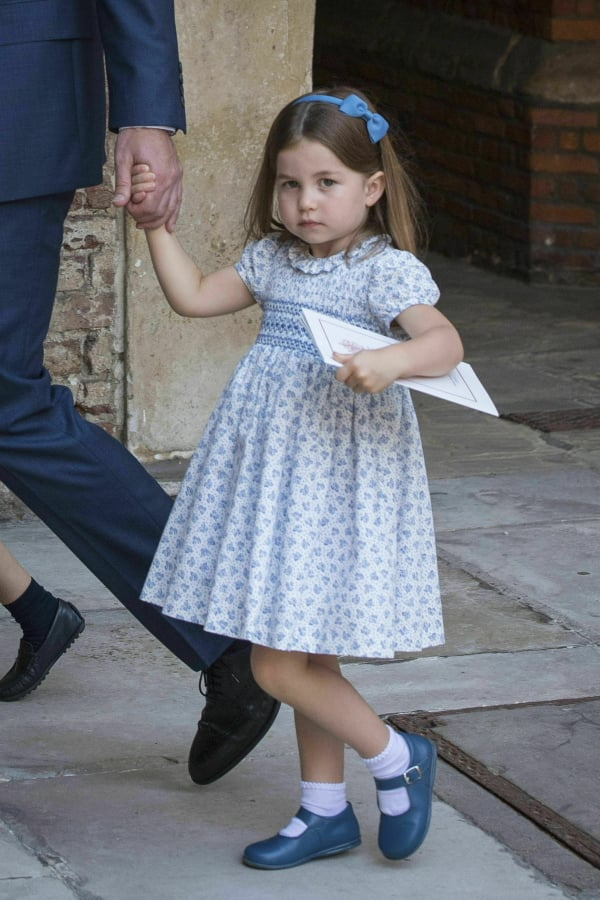 7e591f32f This July 9, 2018 file photo shows Princess Charlotte wearing a blue and  white print