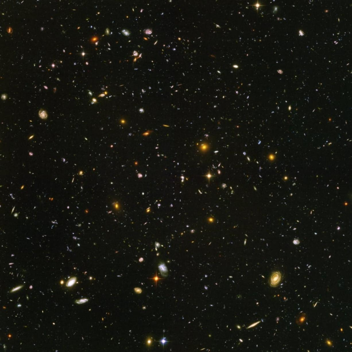 This image made from a composite of September 2003 to January 2004 photos captured by the NASA/ESA Hubble Space Telescope shows nearly 10,000 galaxies in the deepest visible-light image of the cosmos, cutting across billions of light-years. NASA, ESA, S.