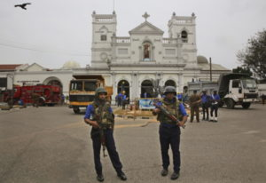 Sri Lankan Naval soldiers stand outside damaged St. Anthony's Church, in Colombo, Saturday, April 27