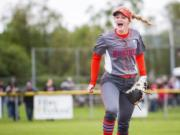Ridgefield's Kaia Oliver celebrates the final out of a 6-5 win over W.F. West on Friday, just two days after coach Dusty Anchors died from heart disease.