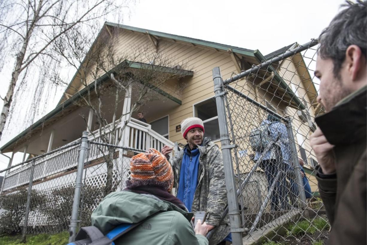 Katelyn Benhoff, lead outreach case manager with Share, left, speaks with Dimitri Coles in front of Share House while performing the annual Point in Time Count on Jan. 24, 2019.