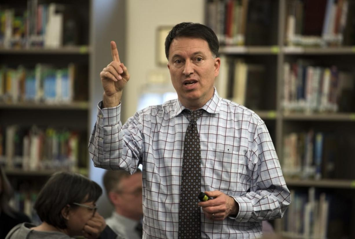 Superintendent Mike Merlino opens up a public forum for community members to voice their input on the district budget reductions at Heritage High School in Vancouver on March 14. Alisha Jucevic/The Columbian