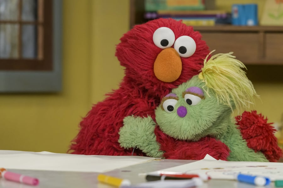 """Elmo hugs Karli, his new friend on """"Sesame Street."""" Elmo will be getting his own talk show on the new HBO Max streaming service."""