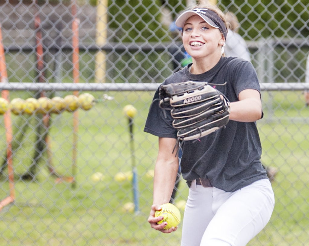 Mountain View junior pitcher Sydney Brown's smile rarely leaves her face. Her 153 strikeouts in 90 innings are intimidating, as is, her grin only throws hitters off even more, catcher Kinsey Martin says.