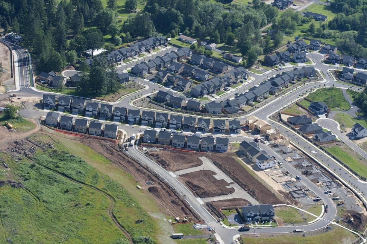 New homes under construction are seen near Woodburn Elementary School in 2016. Amanda Cowan/The Columbian files