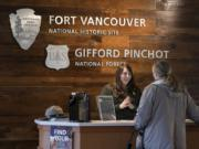 Jacquelyn Scholtz, park guide at Fort Vancouver National Historic Site, assists Bonnie Matz of Portland as she stops by the Visitors Center in January.