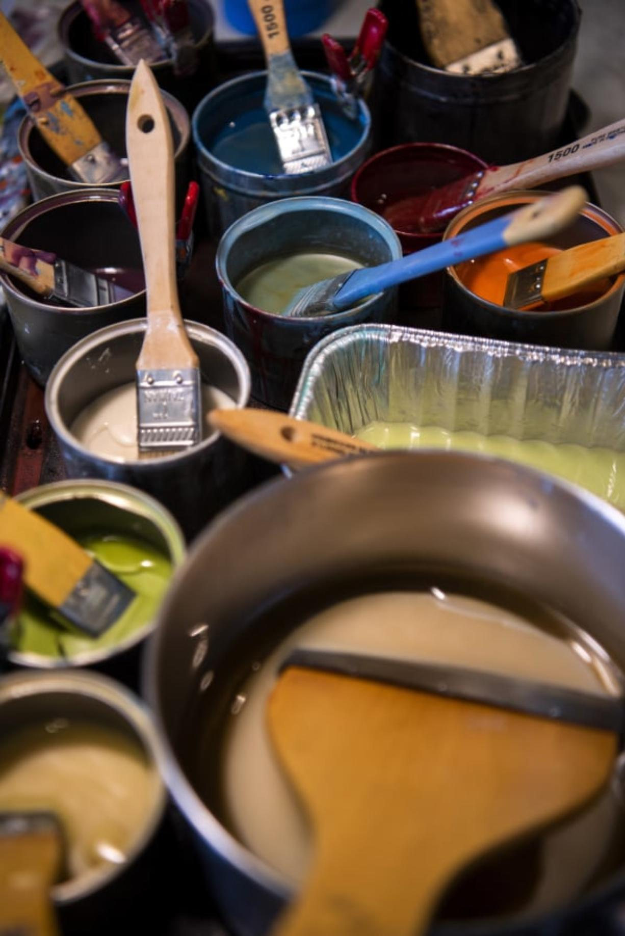 Many colorful mixtures of encaustic (beeswax) and dammar resin sit Tracy Simpson's home studio in Washougal, ready to go; all she has to do is melt them, or make some more, to start adding colors to her works in progress.