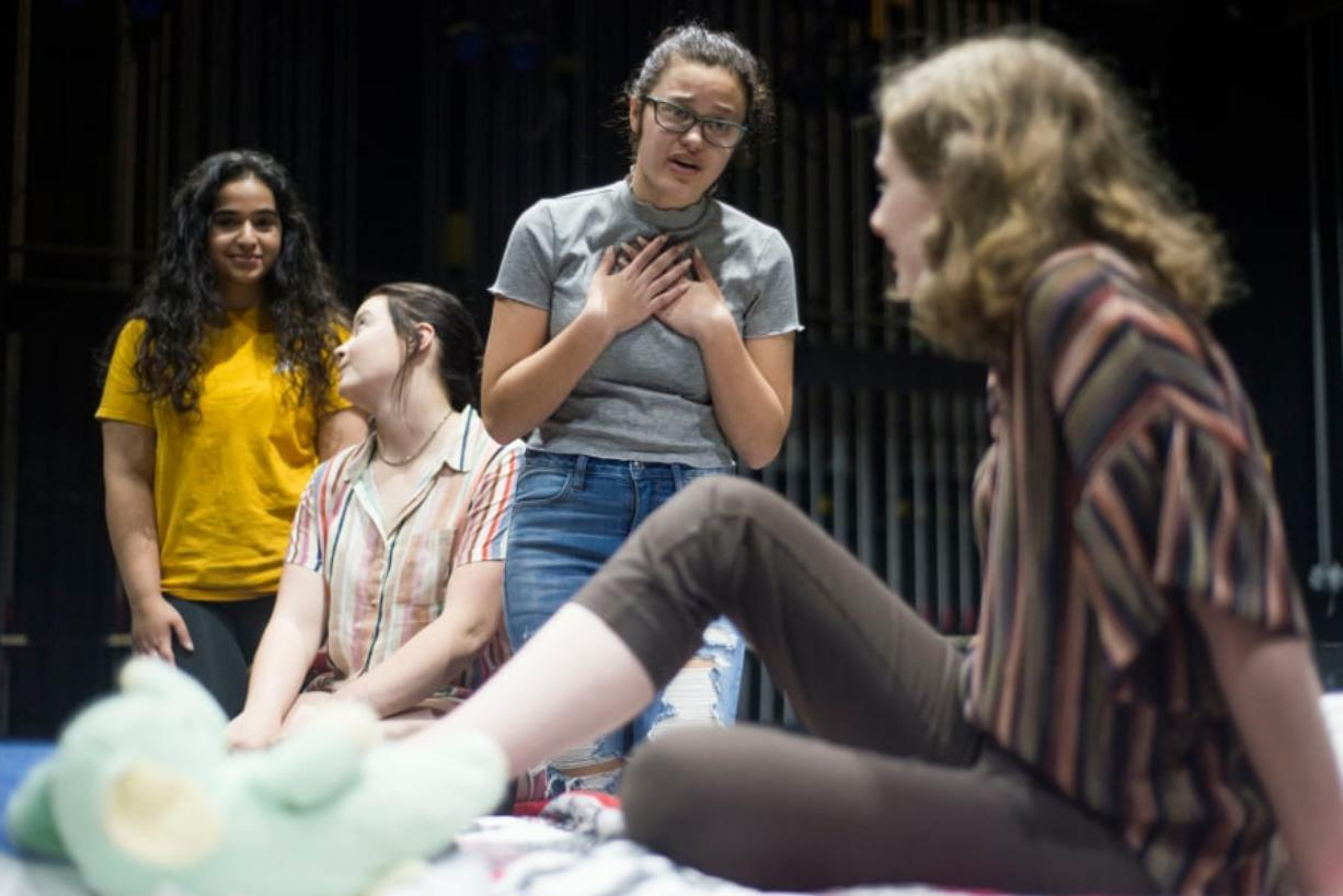 Camas High School theater students Sara Akhtarkhavari, from left, Laura Johnson and Cameron Kolkemo console Rae, the main character played by fellow student Chloe Higgins, during a rehearsal. (Samuel Wilson for The Columbian)