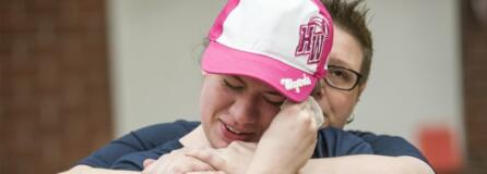 Lauren Reagan, front, is comforted by Copper Long, a family friend, while the jersey of her late son Declan Reagan is presented prior to a Harlem Wizards game at Union High School. The ceremony honored Declan, know as Declan the Dinosaur, who was an honorary draft pick of the Wizards last year. Declan died in May 2018 at age 6 after fighting multiple cancers.