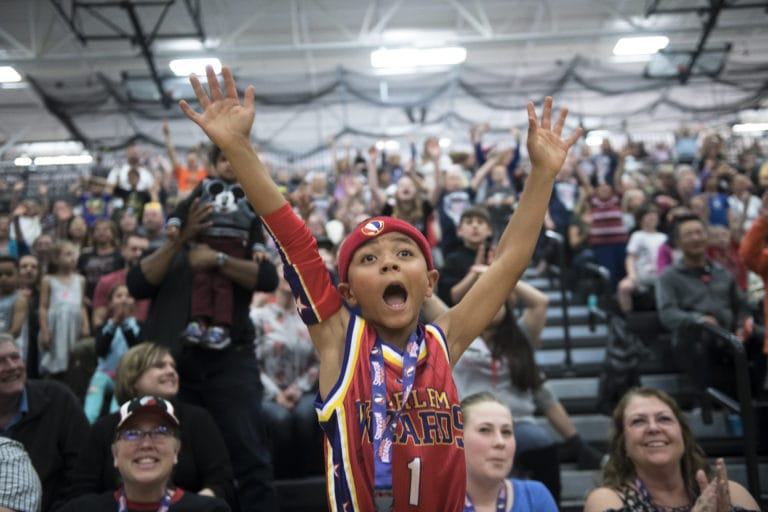Kaden Butler, 7, cheers for the Harlem Wizards during a game at Union High School on Thursday night, May 2, 2019. (Nathan Howard/The Columbian)