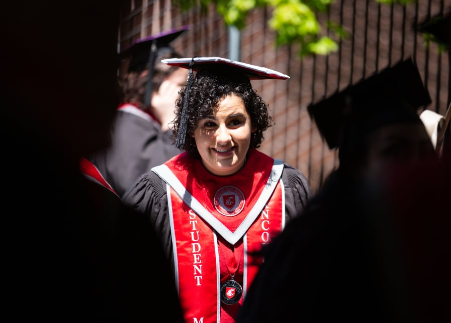 Kassidy Young of Vancouver gathers with her fellow graduates during Saturday's Washington State University Vancouver commencement ceremony at Sunlight Supply Amphitheater. (Roberto Rodriguez for The Columbian)