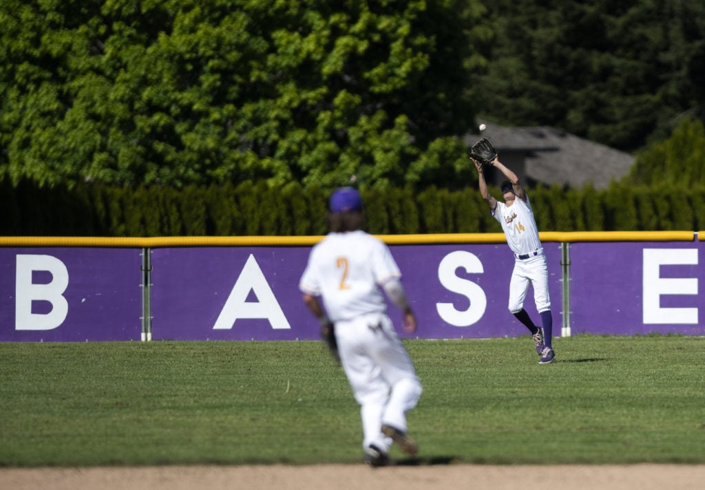 14b030d5e02c0e Columbia River s Parker McNeil (14) catches a fly ball during the game  against Centralia