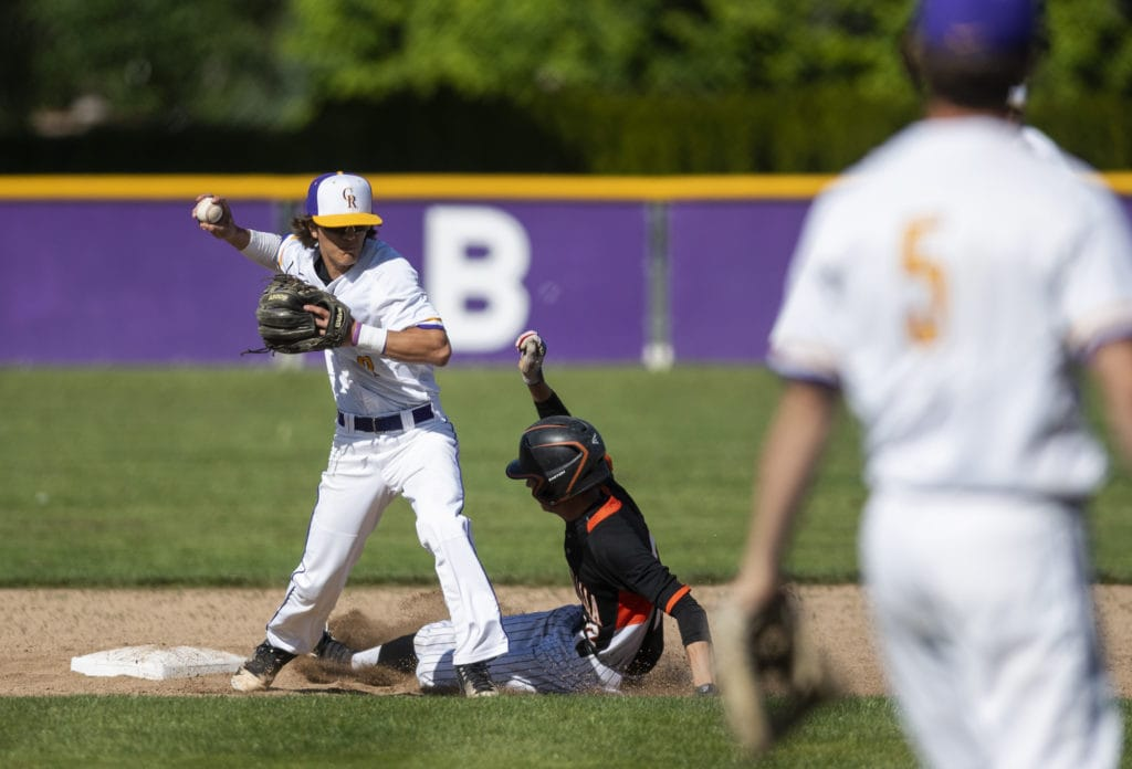 2ba0f85bb2f136 Columbia River s Derek Mettler (2) gains an out on Centralia s Jeremy Wood ( 12