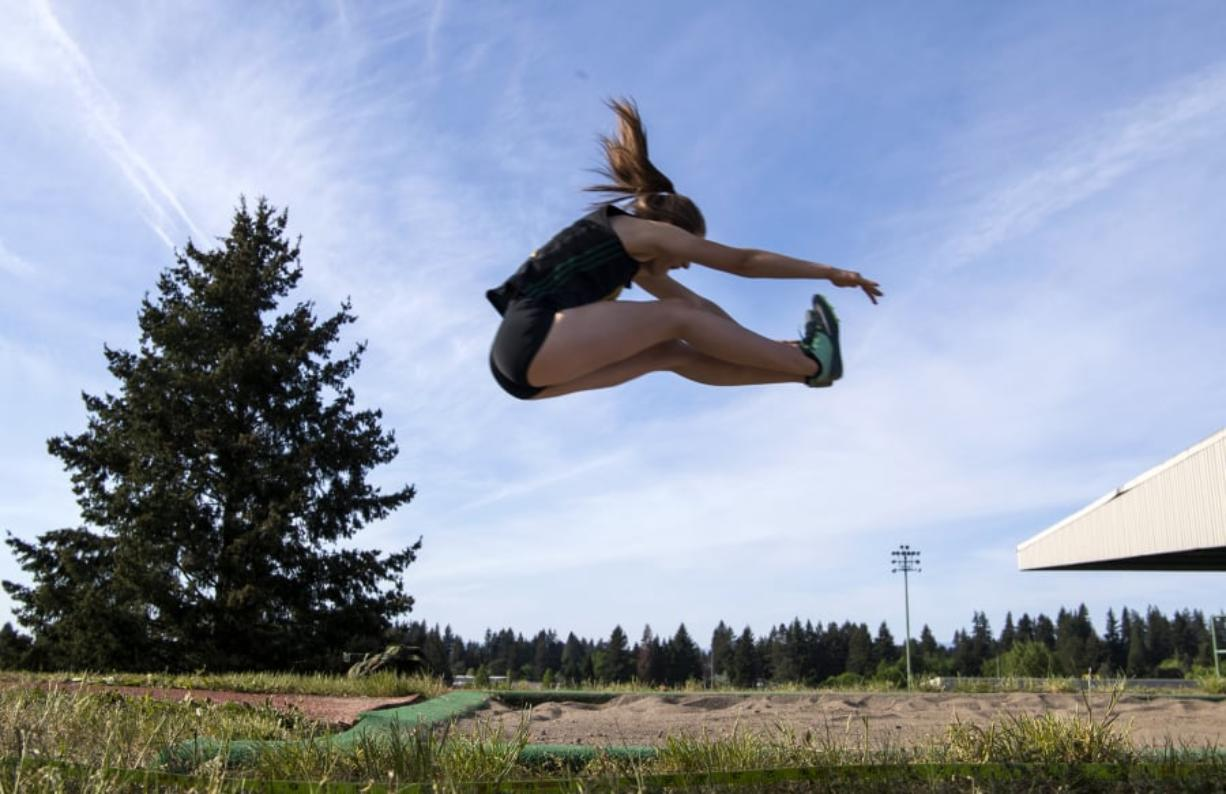Evergreen's Bailey Cunningham competes in the long jump during the Class 3A and 4A district track and field meet.