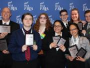 Orchards: Members of the Heritage High School Future Business Leaders of America chapter, which brought home 20 awards from the state conference in Bellevue.