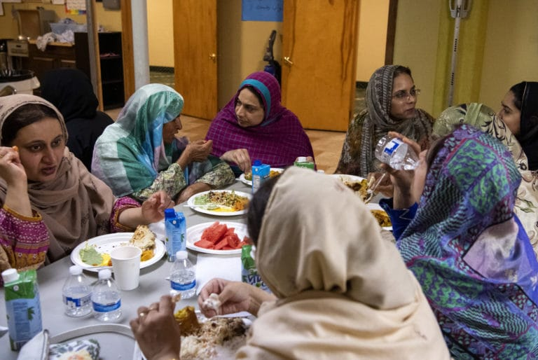 A group of women come together to enjoy their evening meal after sunset during the first week of Ramadan at the Islamic Society of Southwest Washington on Friday, May 10, 2019.   (Alisha Jucevic/The Columbian)
